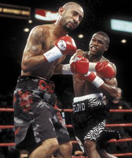 2001: Mayweather put on a tremendous offensive display against Diego Corrales. Corrales at that time had never been knocked down and was a dangerous puncher. Floyd showed aggression and dropped Corrales an astounding 5 times before stopping him. During the spectacle, TV commentators compared Mayweather to greats Sugar Ray Leonard, Pernell Whitaker, Willie Pep, Muhammad Ali
