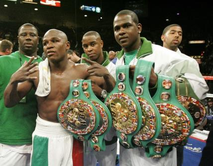 Floyd Mayweather Jr. with some of his WBC championship belts