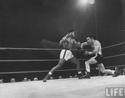 "Sugar Ray Robinson (left) is widely believed to be history's greatest fighter. The term ""pound for pound"" was invented for him. In this historic battle against the great Carmen Basilio, Robinson showcased his masterful skills. When compared with Mayweather he is just as strong and quick but less tidy, often being open for counters and off-balance"
